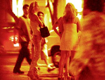 A typical busy night in Waikiki brings residents, tourists and young  prostitutes to the streets.