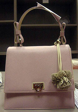 f817bded7b Salvatore Ferragamo  Is offering a limited number of updated mini Kelly bag  ( 900) in cipria pink Saffiano pebble calf with magnolia white Saffiano  trim