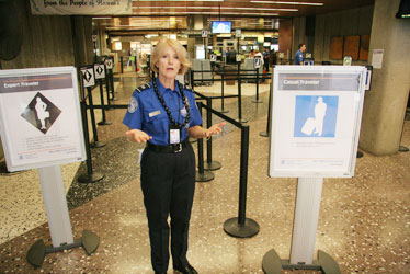 transportation security administration officer linda kobus stood yesterday at a honolulu airport checkpoint where travelers can now choose different entry